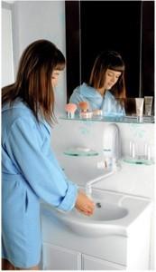 Woman wash hands using Dafi water heater